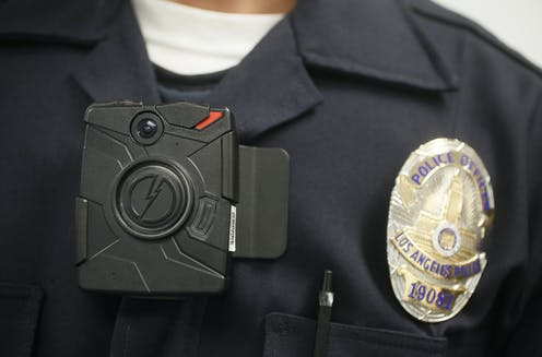 A police officer wears a body camera