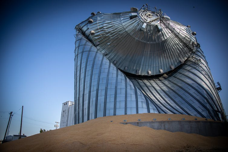 Metal silo twisted and folded by winds.