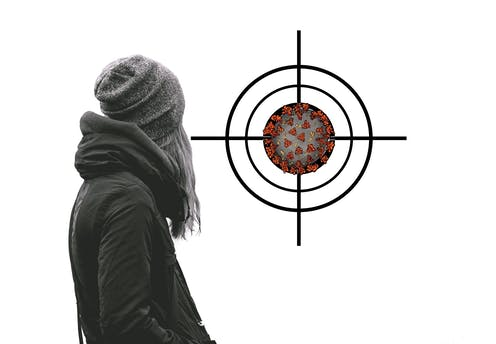 Person with their back to camera, looking at a coronavirus in a target.