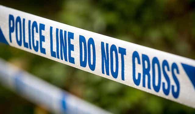 Police tape stating: 'do not cross'.