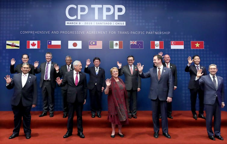 Leaders of the member states of the CPTPP pose for a photo before signing the agreement in March 2018.