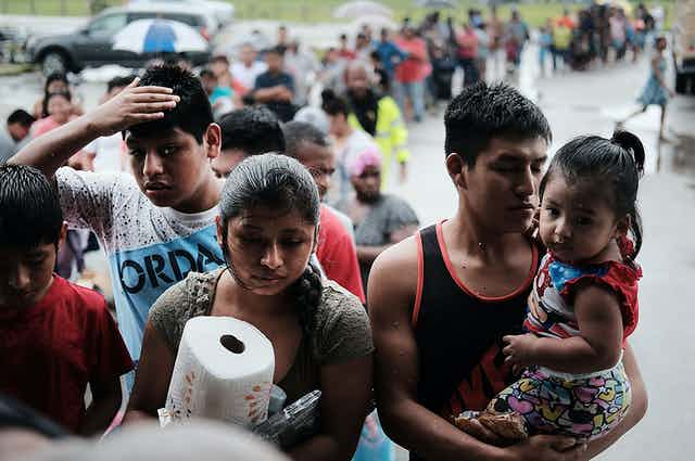 Migrants receive paper towels and other supplies