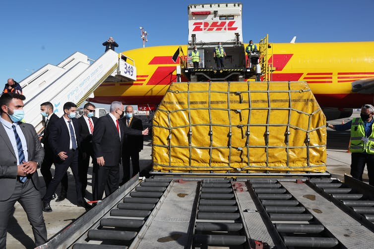 Israel's Prime Minister Benjamin Netanyahu attends the arrival of more than 100,000 doses Pfizer vaccines at Ben Gurion Airport on December 9 2020.