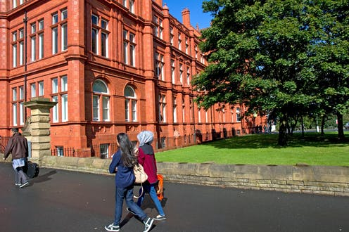 Students walking on the University of Salford's Peel Park Campus