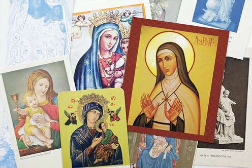 Holy cards featuring depictions of the Virgin Mary.