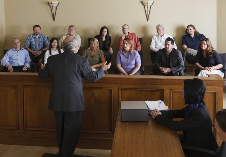 Lawyer speaking to jurors in a courtroom