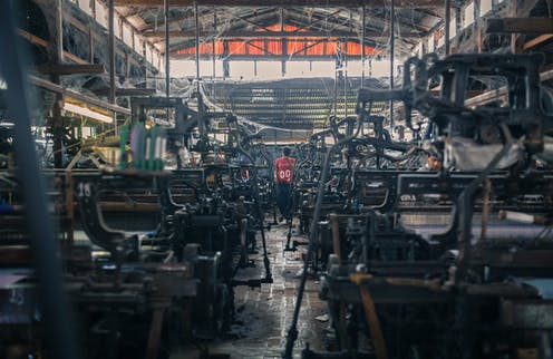 Grim looking clothing factory with machines