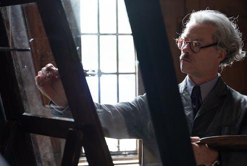 A man paints