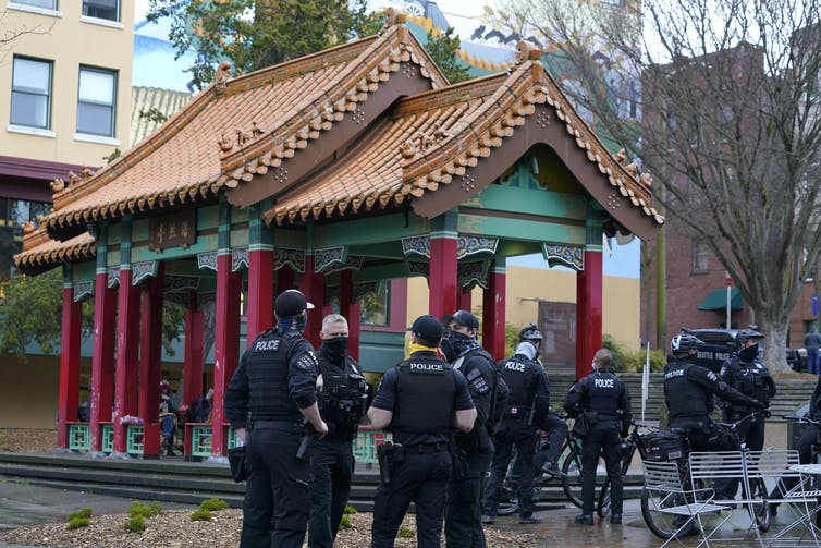 Police in a park in Seattle's Chinatown