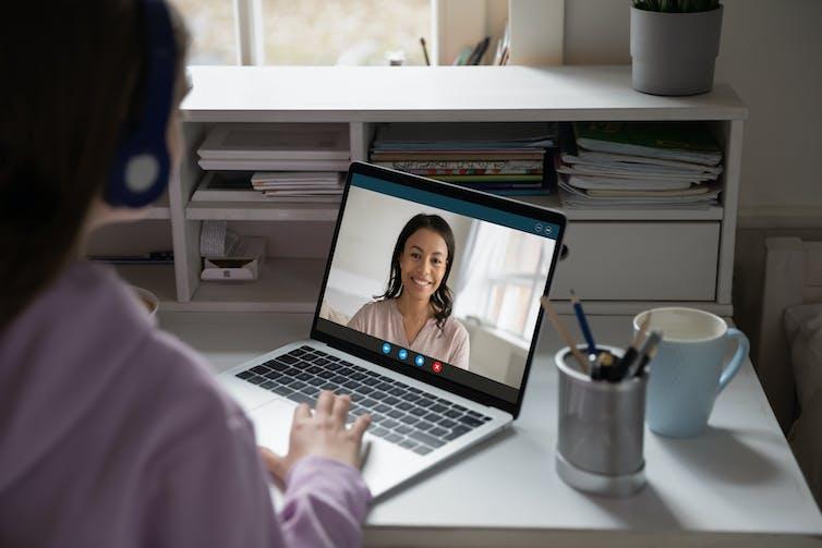 A woman attending a virtual class.