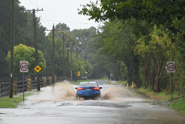 A car drives through flood waters