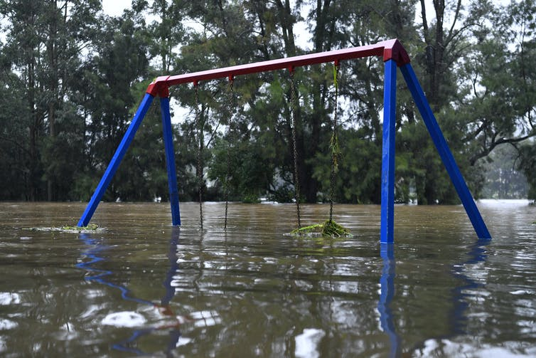 A playground is submerged in floodwaters.