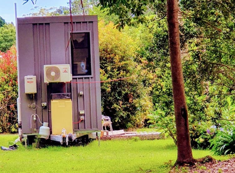 Tiny house on wheels in a garden