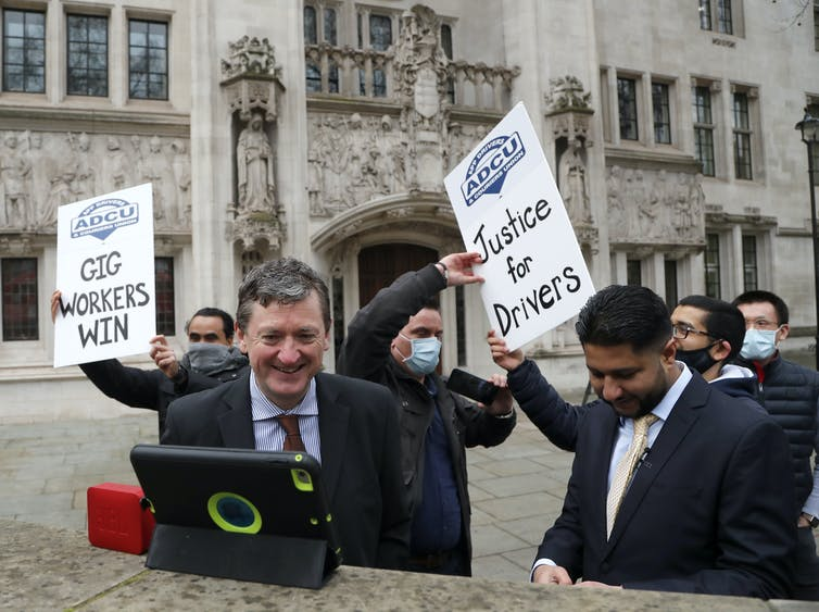 Former Uber drivers James Farrar and Yaseen Aslam celebrate the UK Supreme Court's decision on February 19 2021.