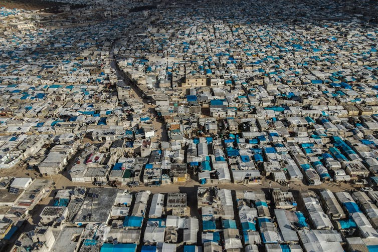Aerial view of rows of tents at refugee camp