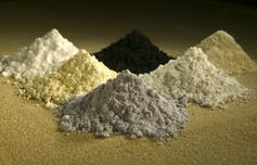 Piles of rare earth elements, clockwise from top center: praseodymium, cerium, lanthanum, neodymium, samarium and gadolinium