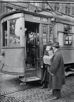 men with a streetcar