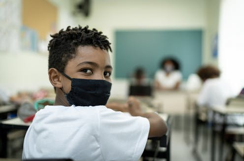 Boy with mask in classroom