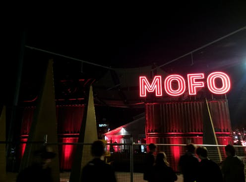 Neon red sign reading 'Mofo'