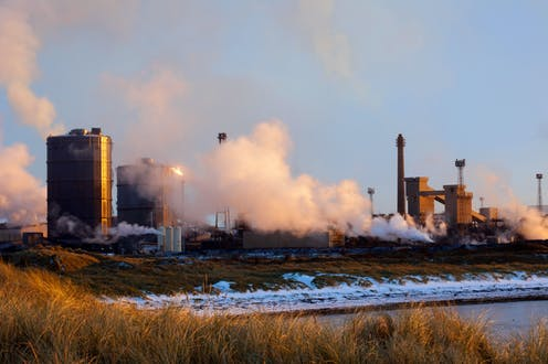 An industrial scene on the coast during winter.