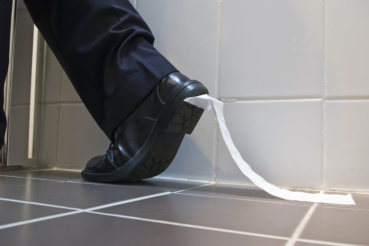 Toilet paper stuck to shoe leaves bathroom