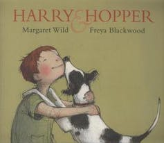 Cover of Harry and hopper featuring a boy hugging a dog.