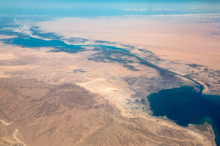 An aerial view of the Suez Canal with desert on either side.