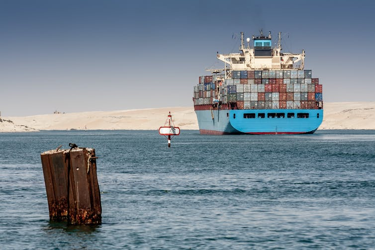 A large container vessel sailing the Suez Canal.