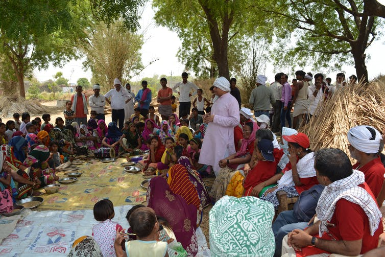People gathered in a village in India