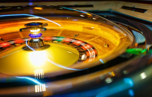 A ball moves across a roulette wheel