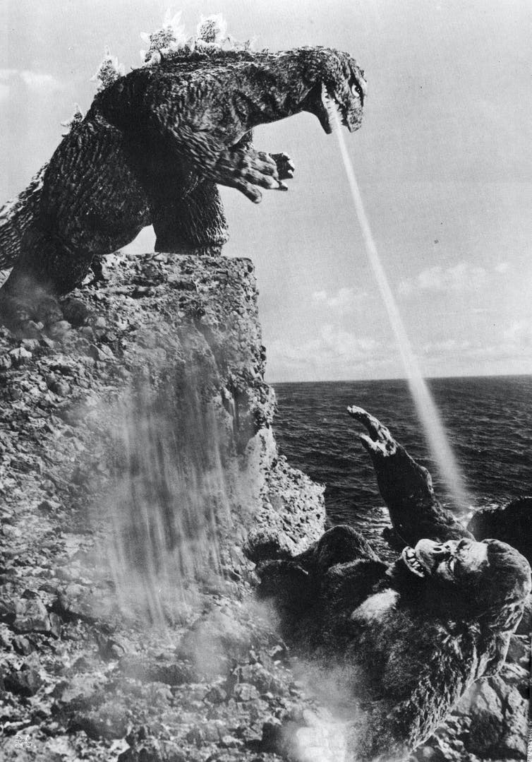 Godzilla shooting King Kong with his atomic breath from the 1962 film 'King Kong vs. Godzilla'