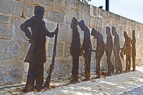 Sculpture of convicts in silhouette