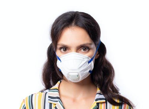 A woman wearing an N95 face mask
