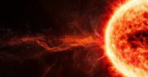 An illustration of a solar flare coming out from the Sun.