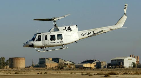 A UN helicopter with weapons inspectors on board takes of from an oil facility near the city of al-Hadithah, 300km northwest of Baghdad, 11 January 2003.