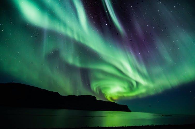 The northern lights over a lake.