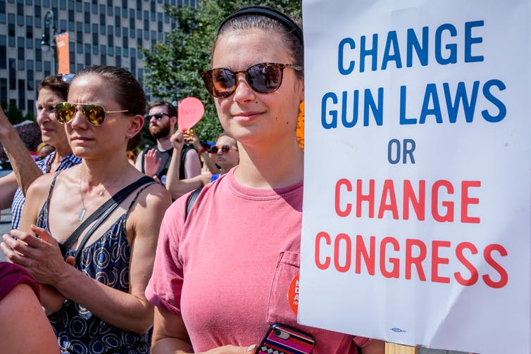 'Change gun laws or change Congress' reads a sign at a 2018 rally in New York City.