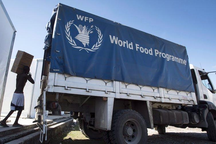 A worker loads a truck.