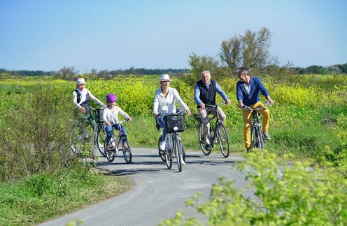 Multigenerational group of people biking