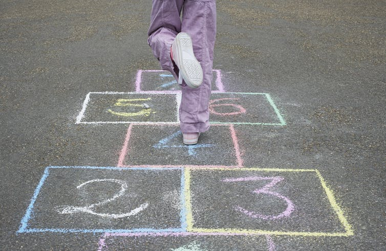 Child on hopscotch grid