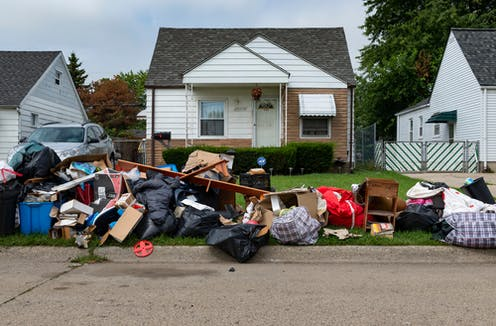 Home in Detroit with belongings piled outside
