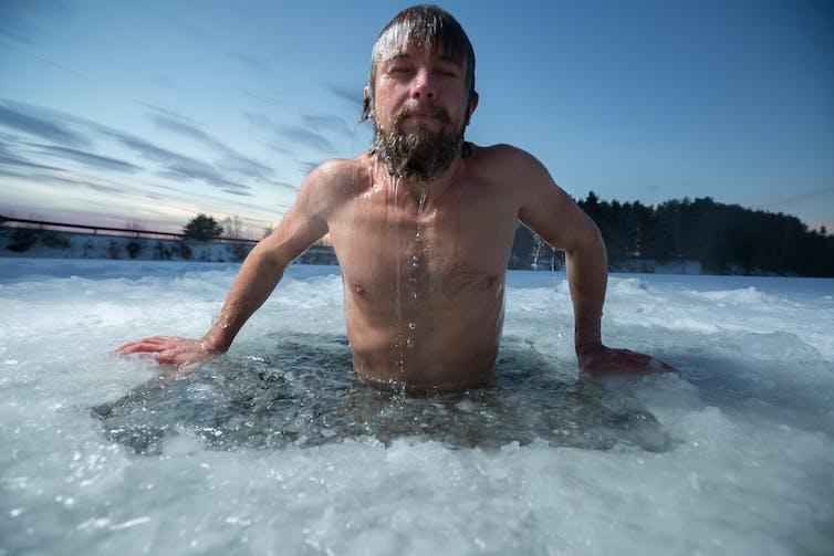 Man swimming in freezing water.