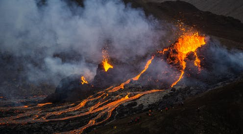 Molten lava flowing from a small volcanic eruption in Mt Fagradalsfjall, near the capital of Reykjavik, Southwest Iceland.