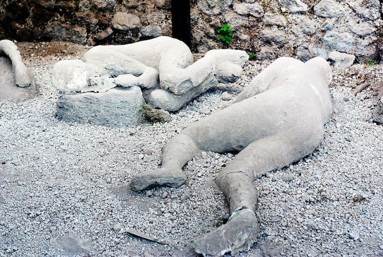 Two plaster casts of victims of the Vesuvius eruption in Pompeii.