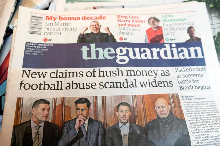 Front page of the Guardian newspaper with the headline 'New claims of hush money as football abuse scandal widens'