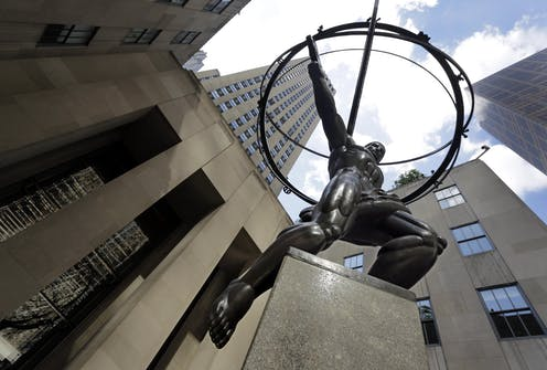A statue of Greek god atlas stands in the shadow of Rockefeller Center in New York City
