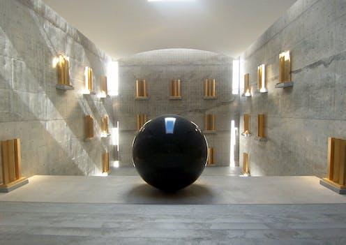 Black orb in light filled room