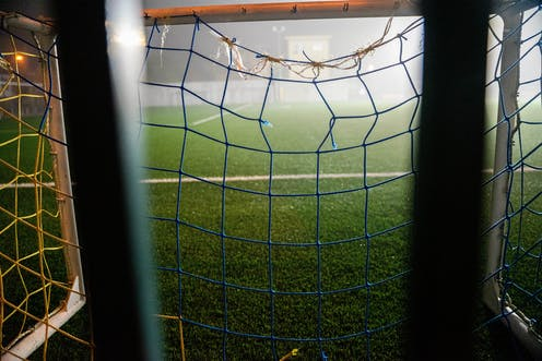 Football net with a hole in it