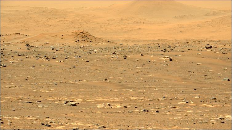 Yellowish orange sandy surface of Mars.