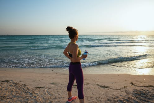 woman in activewear on beach